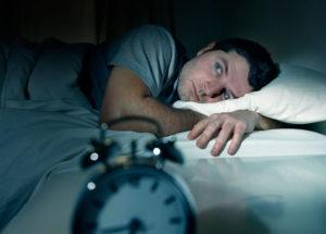 man awake in bed